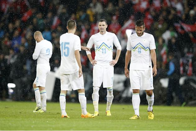 Slovenia's Miso Brecko, Andraz Struna, Milivoje Novakovic and Jasmin Kurtic, from left, look on after the FIFA World Cup 2014 group E qualifying soccer match between Switzerland and Slovenia at the St