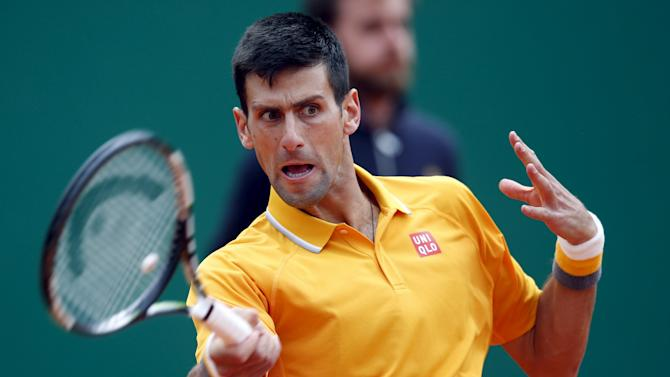 Djokovic of Serbia returns the ball to Berdych of the Czech Republic during their final tennis match at the Monte Carlo Masters in Monaco