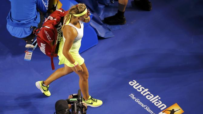 Azarenka of Belarus reacts as she leaves the court after losing to Cibulkova of Slovakia in their women's singles fourth round match at the Australian Open 2015 tennis tournament in Melbourne