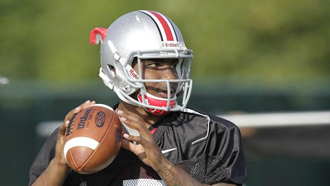 Ohio State quarterback Braxton Miller warms up during an NCAA college football practice on Saturday, Aug. 9, 2014, in Columbus, Ohio