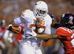 No. 14 Texas beats Mississippi, 66-31