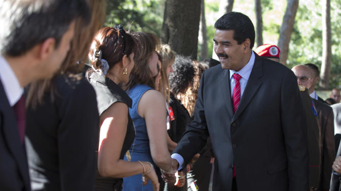 Venezuelan President Nicolas Maduro is greeted by far left-wing activists as he arrives to make a press statement, in Rome, Sunday, June 16, 2013. Maduro is scheduled to meet Pope Francis Monday, June 17, during a private audience at the Vatican. (AP Photo/Andrew Medichini)