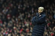 "Arsenal manager Arsene Wenger watches the action from the touchline during the UEFA Champions League clash with Bayern Munich on February 19, 2013. Wenger admitted that his team had been ""a bit nervous"", after a 3-1 home loss"