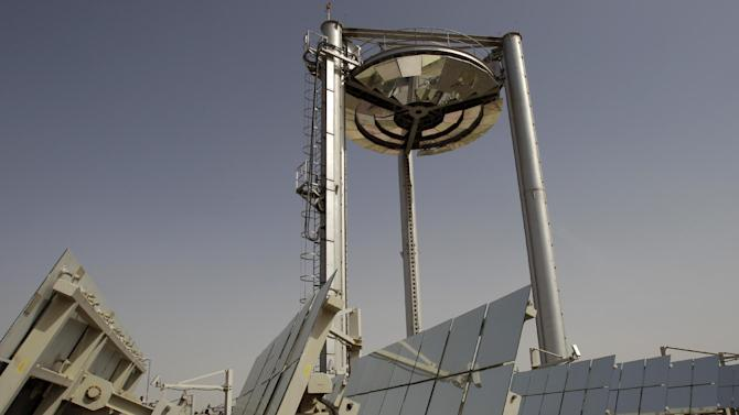 FILE - In this Sunday, Jan. 16, 2011 file photo, the Beam Down Pilot project, a joint pilot project of the Masdar Institute of Science and Technology, Japan's Cosmo Oil Company and the Tokyo Institute of Technology, takes the conventional concentrated solar power design and literally turns it to on its head at Masdar City in Abu Dhabi, United Arab Emirates. Hosting the climate talks is the latest bid by Qatar to flex its muscles on the international stage, following its successful bid to host the 2022 World Cup and its backing of Libyan and Syrian rebels. (AP Photo/Kamran Jebreili, File)