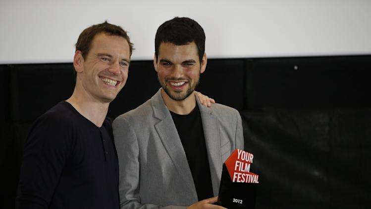 Actor Michael Fassbender, and David Victori Blaya of Spain, winner of the 'Your Film Festival' award at the 69th edition of the Venice Film Festival in Venice, Italy, Sunday, Sept. 2, 2012. (AP Photo/Andrew Medichini)