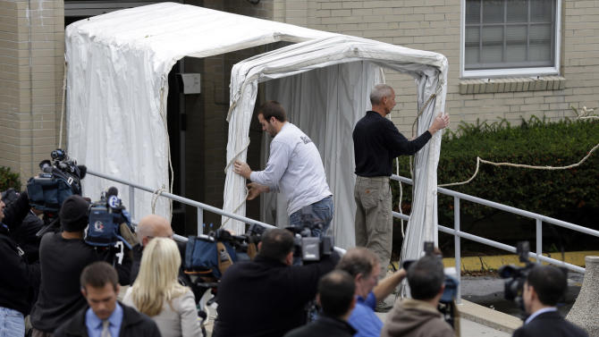 A privacy tunnel is erected at the Centre County Courthouse Monday, Oct. 8, 2012, in Bellefonte, Pa. Former Penn State University assistant football coach Jerry Sandusky is scheduled to be sentenced Tuesday for sexually abusing 10 boys in a scandal that rocked the university and brought down coach Joe Paterno. (AP Photo/Matt Rourke)