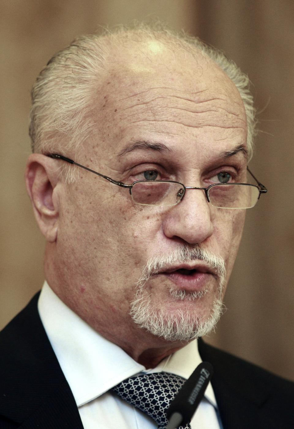 Hussein al-Shahristani, deputy Prime Minister for Energy speaks to the press in Baghdad, Iraq, Wednesday, Oct. 10, 2012. Iraq's top energy official is predicting that the country's current oil production of 3.4 million barrels per day will double by 2015. (AP Photo/Hadi Mizban)
