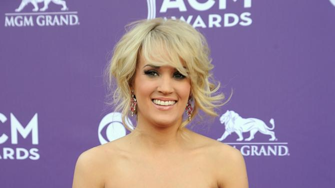 Singer Carrie Underwood arrives at the 48th Annual Academy of Country Music Awards at the MGM Grand Garden Arena in Las Vegas on Sunday, April 7, 2013. (Photo by Al Powers/Invision/AP)