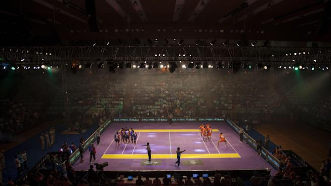 In this Aug. 6, 2014 photo, Indians watch a Pro Kabaddi League match in New Delhi, India. Kabaddi, an ancient South Asian sport, has not only turned modern but suddenly has two international leagues to boast of. Now there's two professional international leagues - one in India and another which recently kicked off in London. Backers of the pro leagues are marketing slick new versions of kabaddi that they hope will compete with the mushrooming franchise-based sports leagues in India - particularly cricket, the runaway success story of them all. (AP Photo/Tsering Topgyal)