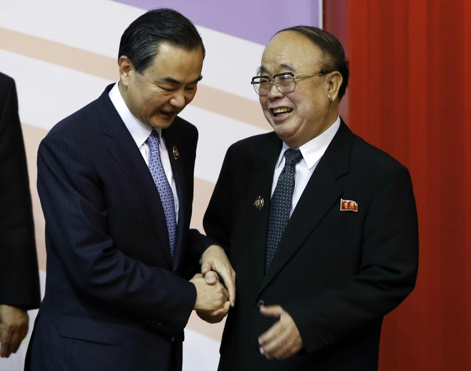 China's Foreign Minister Wang Yi, left, talks with North Korea's Foreign Minister Pak Ui Chun during a group photo session for ASEAN Regional Forum Foreign Ministers' Meeting in Bandar Seri Begawan, Brunei, Tuesday, July 2, 2013. (AP Photo/Vincent Thian)