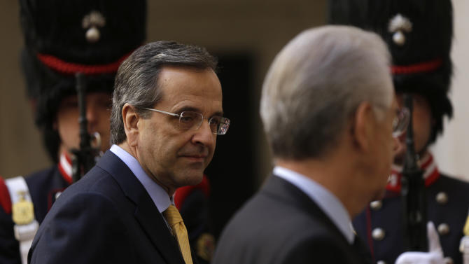 Greek Prime Minister Antonis Samaras,  left, with his Italian counterpart Mario Monti, at Palazzo Chigi government office in Rome, Friday, Sept. 21, 2012. (AP Photo/Alessandra Tarantino)