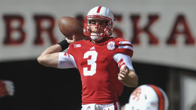 Nebraska quarterback Taylor Martinez (3) throws in the first half of an NCAA college football game against Idaho State, in Lincoln, Neb., Saturday, Sept. 22, 2012. (AP Photo/Dave Weaver)