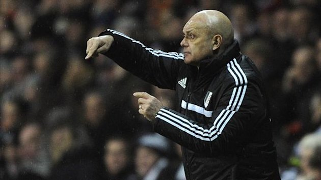 Fulham's assistant head coach Ray Wilkins gestures on the touchline during their Premier League match against Swansea City (Reuters)