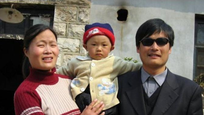 This undated photo provided by the China Aid Association shows blind Chinese legal activist Chen Guangchen, right, with his son, Chen Kerui, with his wife Yuan Weijing, left, in Shandong province, China. Chen, a well-known dissident who angered authorities in rural China by exposing forced abortions, made a surprise escape from house arrest on April 22, 2012, into what activists say is the protection of U.S. diplomats in Beijing, posing a delicate diplomatic crisis for both governments. (AP Photo/www.ChinaAid.org)