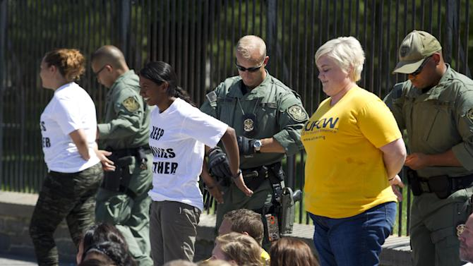 Demonstrators are arrested outside the White House in Washington on Thursday