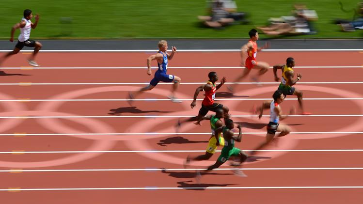 Jamaica's Yohan Blake leads a men's 100-meter heat during the athletics in the Olympic Stadium in the Olympic Park during the 2012 Summer Olympics in London, Saturday, Aug. 4, 2012. (AP Photo/Mark J. Terrill)