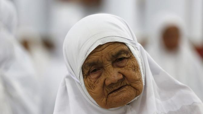 Acehnese woman attends a mass prayer for the 2004 tsunami victims at Baiturrahman Grand Mosque in Banda Aceh
