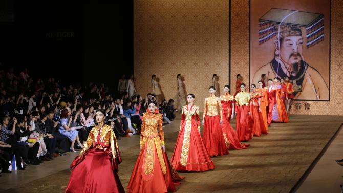 Models present creations from 2014 NE TIGER Haute Couture Collection at China Fashion Week in Beijing