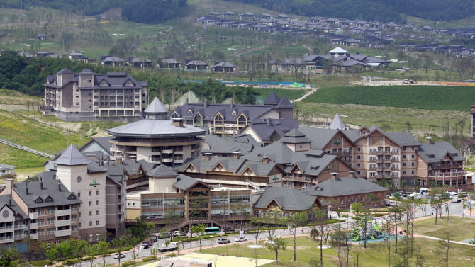 FILE - In this July 7, 2011 file photo, Alpensia resort, one of the venues for the 2018 Winter Olympics, is pictured in Pyeongchang, South Korea. The people of Pyeongchang can confidently promise two things when they host the Olympics: it'll be cold, and there'll be no concerns about snow. While a warm spell has created challenging conditions for the skiers and snowboarders competing in the mountains above Sochi at the 2014 edition, there's been heavy dumps of snow in the region that will host the next Winter Games in 2018. (AP Photo/Lee Jin-man, File)