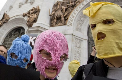 "<p>Supporters of punk group Pussy Riot, wearing the group's trademark coloured balaclavas, hold individual letters that spell the phrase ""Blessed are the merciful"" outside the Church of Christ the Saviour in central Moscow on August 15. Investigators said Monday they launched a fresh criminal probe against members of Pussy Riot who remained free after an anti-Vladimir Putin stunt in the church.</p>"
