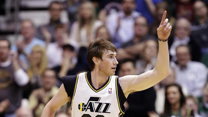 Utah Jazz's Gordon Hayward (20) runs upcourt after scoring against the Boston Celtics in the second quarter during an NBA basketball game, Monday, Feb. 25, 2013, in Salt Lake City. (AP Photo/Rick Bowmer)