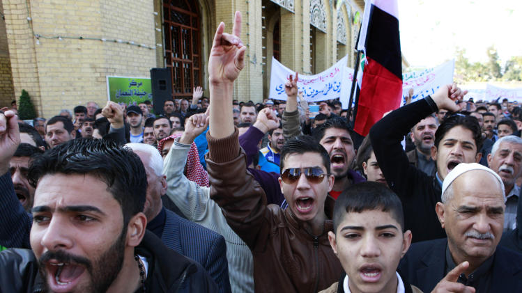 Iraqis chant anti-government slogans during a protest in Baghdad, Iraq, Friday, Feb. 1, 2013. Tens of thousands of Sunni protesters took to the street to complain about the official discrimination against them and to demand the release of Sunni detainees held in Iraqi jails. (AP Photo/Hadi Mizban)