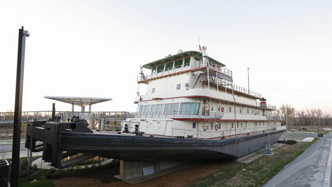 In this Dec. 18, 2012 photograph, the U.S. Army Corps of Engineers towboat and inspection vessel, Motor Vessel Mississippi IV, sits in a permanent dry dock as part of the Lower Mississippi River Museum in Vicksburg, Miss. The museum provides visitors with a extensive look at life surrounding the Mississippi River through several centuries by way of its interactive and static displays. Visitors also have the opportunity to tour aboard the vessel and see how crews worked and lived on the towboats used by the Corps of Engineers. (AP Photo/Rogelio V. Solis)