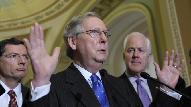 Senate Minority Leader Mitch McConnell of Ky., center, flanked by Sen. John Barrasso, R-Wyo., left, and Senate Minority Whip John Cornyn of Texas, gestures during a news conference on Capitol Hill in Washington, Tuesday, March 12, 2013.  (AP Photo/Susan Walsh)
