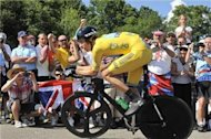 Wiggins storms time trial to stay in yellow