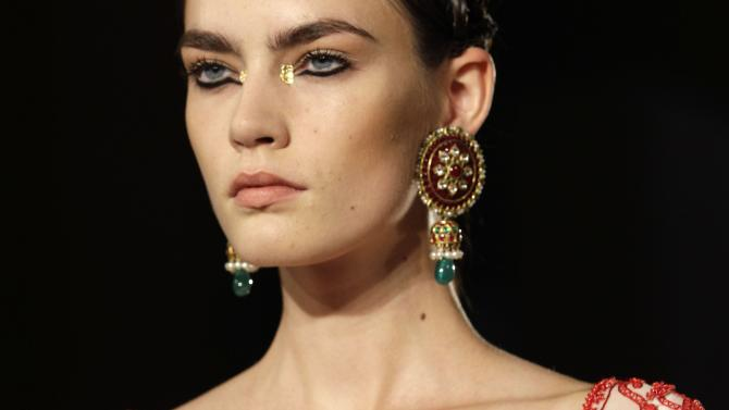 A model wears a design from the Marchesa Spring 2013 collection at Fashion Week in New York, Wednesday, Sept. 12, 2012.  (AP Photo/Kathy Willens)
