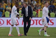 English head coach Roy Hodgson congratulates English midfielder Ashley Young (L) after the Euro 2012 football championships match England vs Ukraine on June 19, at the Donbass Arena in Donetsk. Hodgson has praised his squad&#39;s burgeoning team spirit as they prepare for the challenge of Sunday&#39;s Euro 2012 quarter-final showdown with Italy