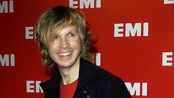 """FILE - This Feb. 8, 2004 file photo singer Beck arrives for the EMI party after the Grammy Awards in Los Angeles. Beck hopes the """"Song Reader"""" inspires some of us to pick up instruments and limber our vocal cords. It includes 20 songs annotated on sheet music that's been decorated in the style popular in the early 20th century when the songwriting industry was a thriving enterprise with billions of songs sold. (AP Photo/Kim D. Johnson, file)"""