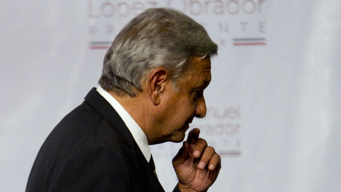 Presidential candidate Andres Manuel Lopez Obrador of the Democratic Revolution Party (PRD) leaves the podium after speaking in Mexico City, Sunday, July 1, 2012. Obrador said he won't concede the presidency despite an official preliminary count that shows him losing to former ruling party candidate Enrique Pena Nieto, of the Institutional Revolutionary Party (PRI), and that he would wait for a full count. (AP Photo/Eduardo Verdugo)