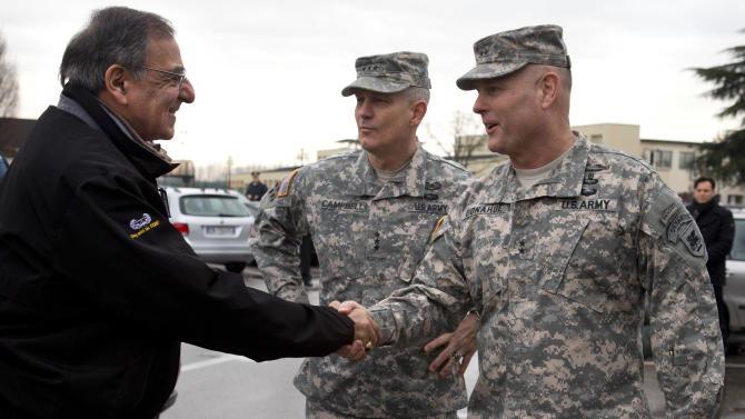 Defense Secretary Leon Panetta, left, is greeted by Commanding General U.S. Army Europe Lt. Gen. Don Campbell, center, and Commanding Gen. U.S. Army Africa Major Gen. Pat Donahue as the secretary arrives to speak to the 173rd Airborne Brigade Combat Team at U.S. Army Garrison in Vicenza, Italy, Thursday, Jan. 17, 2013. Panetta is in Italy as part of a weeklong swing across Europe, meeting with defense ministers to talk about ongoing conflicts in Afghanistan and Mali. This is expected to be Panetta's last overseas trip as Pentagon chief, as he long has planned to step down once his replacement is confirmed. (AP Photo/Jacquelyn Martin)