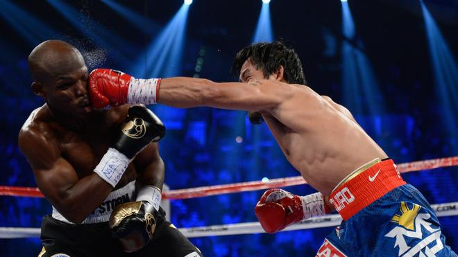 (R-L) Manny Pacquiao Lands Getty Images