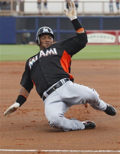 Johnson lead Marlins on mound and at-bat