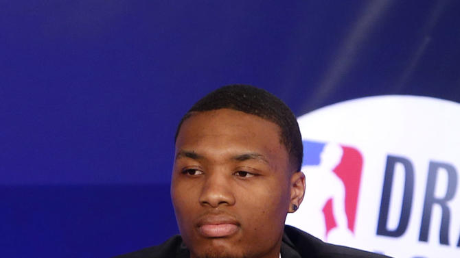 Portland Trailblazers' Damian Lillard represents his team during the NBA basketball draft lottery, Tuesday, May 21, 2013 in New York. (AP Photo/Jason DeCrow)