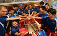 Chinese athletes gathering for a meeting prior to departing for the London Paralympics 2012, in Beijing, August 2012. In Beijing in 2008, 332 Chinese athletes took part -- the largest ever Chinese Paralympic delegation, but only 282 will take part in London, and almost half are debutants at the event