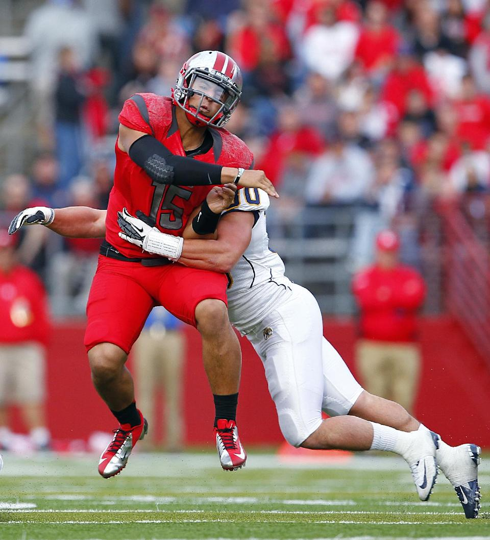 Rutgers quarterback Gary Nova (15) is hit by Kent State's Luke Batton (30) as he throws an interception during the second quarter of an NCAA college football game in Piscataway, N.J., Saturday, Oct. 27, 2012. (AP Photo/Rich Schultz)