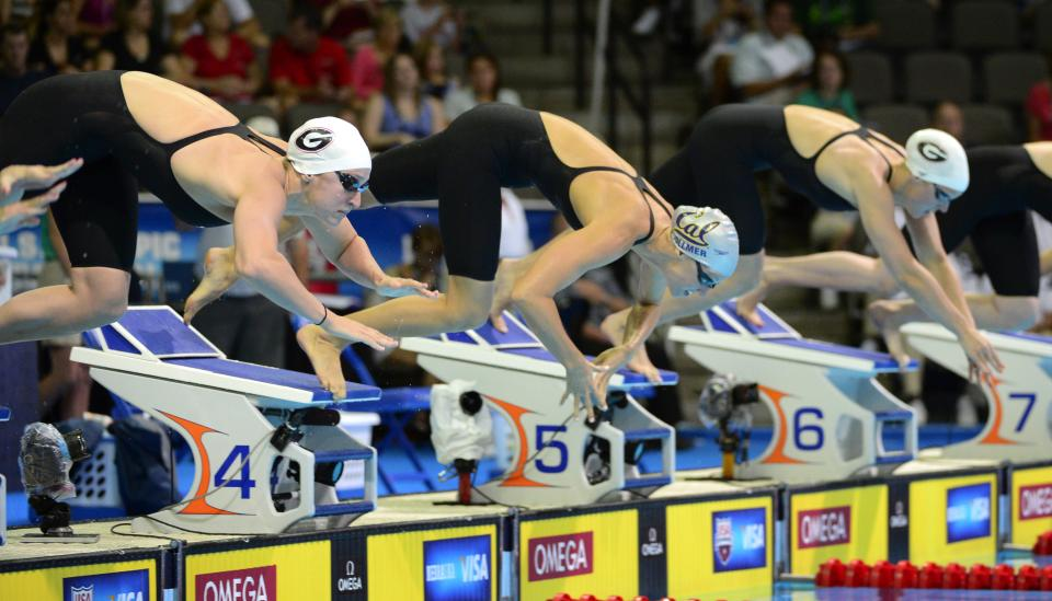 Megan Romano, from left, Dana Vollmer and Chelsea Nauta dive at the start of a heat in the women's 200-meter freestyle preliminaries at the U.S. Olympic swimming trials, Wednesday, June 27, 2012, in Omaha, Neb. (AP Photo/Mark J. Terrill)