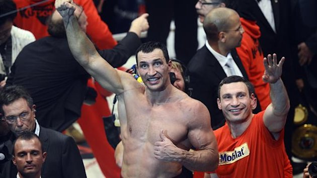 Wladimir Klitschko celebrates his win over Mariusz Wach in Hamburg with brother Vitali