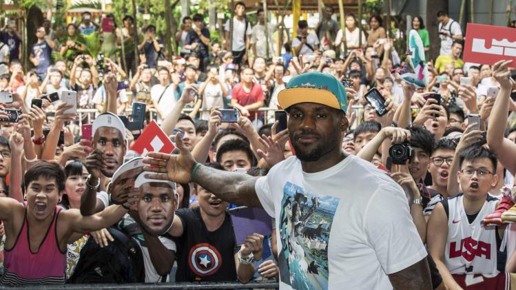 LeBron James greets fans during a promotional event in Hong Kong