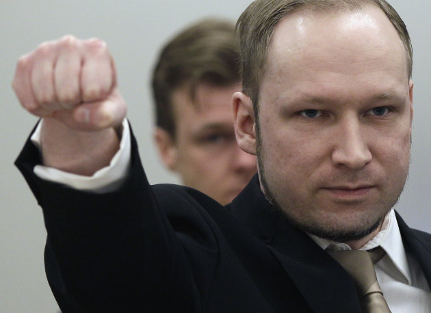 FILE This Monday, April 16, 2012 file photo shows Anders Behring Breivik gesturing as he arrives at the courtroom in Oslo, Norway. (AP Photo/Frank Augstein)