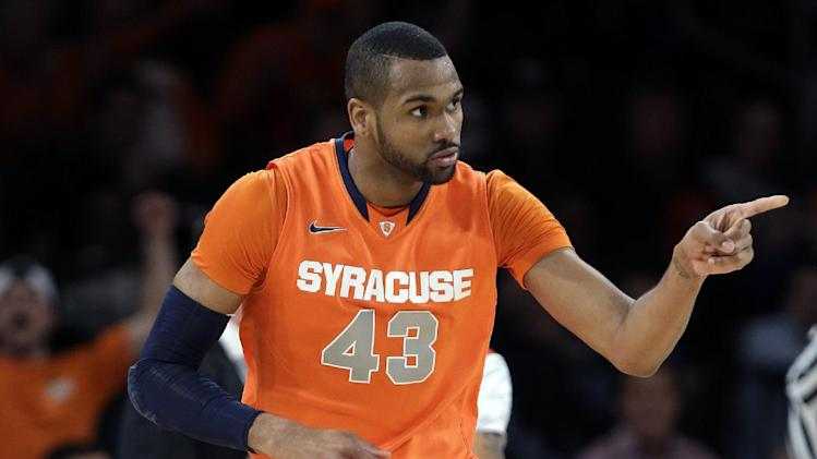 Syracuse's James Southerland (43) reacts after scoring during the first half of an NCAA college basketball championship game against Louisville at the Big East Conference tournament Saturday, March 16, 2013, in New York. (AP Photo/Frank Franklin II)