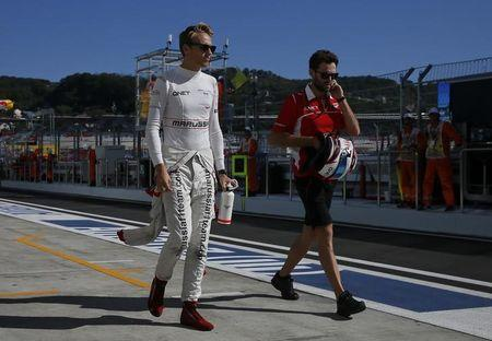 Chilton walks along the pitlane after the third free practice session at the Russian F1 Grand Prix in the Sochi Autodrom circuit.