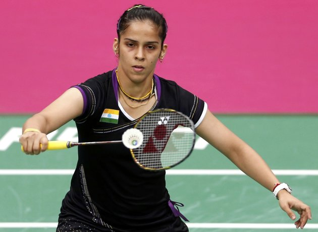 India's Saina Nehwal plays against China's Yihan Wang during their womens singles badminton semifinals match during the London 2012 Olympic Games at the Wembley Arena