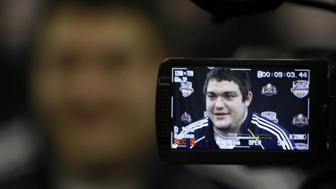 Notre Dame offensive tackle Zack Martin is show in the viewfinder of a television camera as he answers questions during a media availability, Friday, Jan. 4, 2013 in Fort Lauderdale, Fla. Notre Dame is scheduled to play Alabama on Monday, Jan. 7, in the BCS national championship NCAA college football game. (AP Photo/Wilfredo Lee)