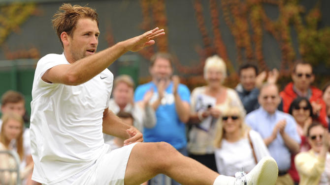 Poland's Lukasz Kubot celebrates defeating France's Adrian Mannarino during day seven of the All England Lawn Tennis championship at Wimbledon London Monday July 1, 2013. (AP Photo/Dominic Lipinski/PA) UNITED KINGDOM OUT
