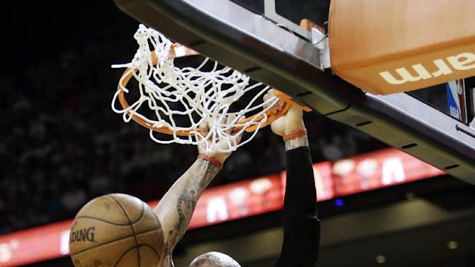 Chicago Bulls forward Carlos Boozer dunks during the second half of Game 1 of the NBA basketball playoff series in the Eastern Conference semifinals against the Miami Heat, Monday, May 6, 2013 in Miami. (AP Photo/Lynne Sladky)