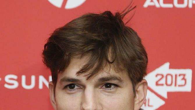 """File - In this Jan. 25, 2013 file photo, actor Ashton Kutcher, who portrays Apple's Steve Jobs in the film """"jOBS,"""" poses at its premiere during the 2013 Sundance Film Festival, in Park City, Utah. Los Angeles prosecutors say a 12-year-old boy admitted Monday, March 11, 2013, to making prank 911 calls that drew a large police response to  Kutcher's home last year. The boy, who has not been publicly identified, will be sentenced at a later date. (Photo by Danny Moloshok/Invision/AP, File)"""